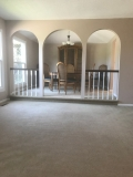 Walk upstairs and look to the left, you'll see THIS! Sitting room with step-up formal dining